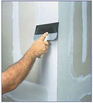 This photo illustrates level 4 gypsum drywall finishing - tape and fill
